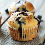 Blueberry Amish Friendship Bread Muffins on a wooden table