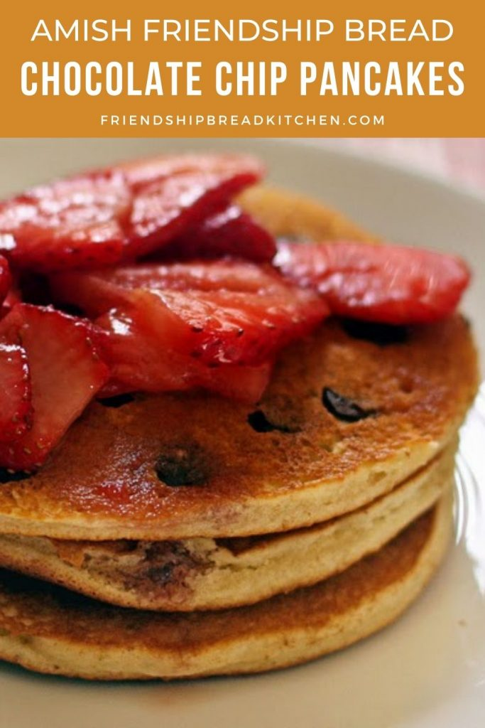 stack of chocolate chip pancakes with strawberries