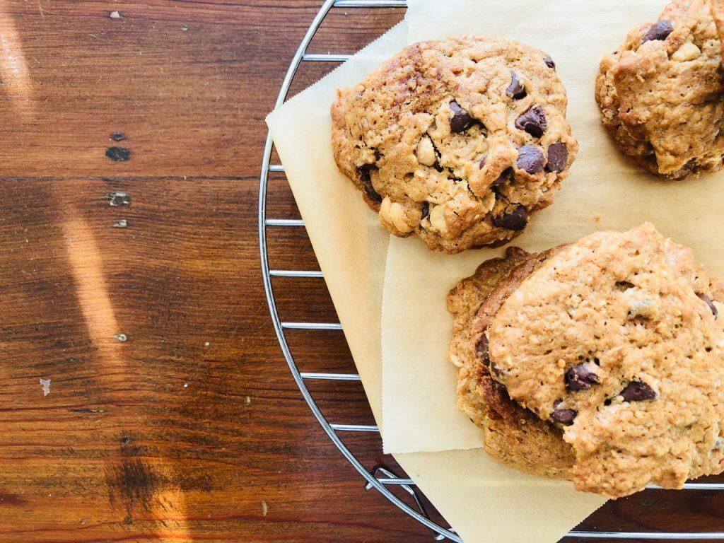 Amish Friendship Bread dump cookies on parchment paper.
