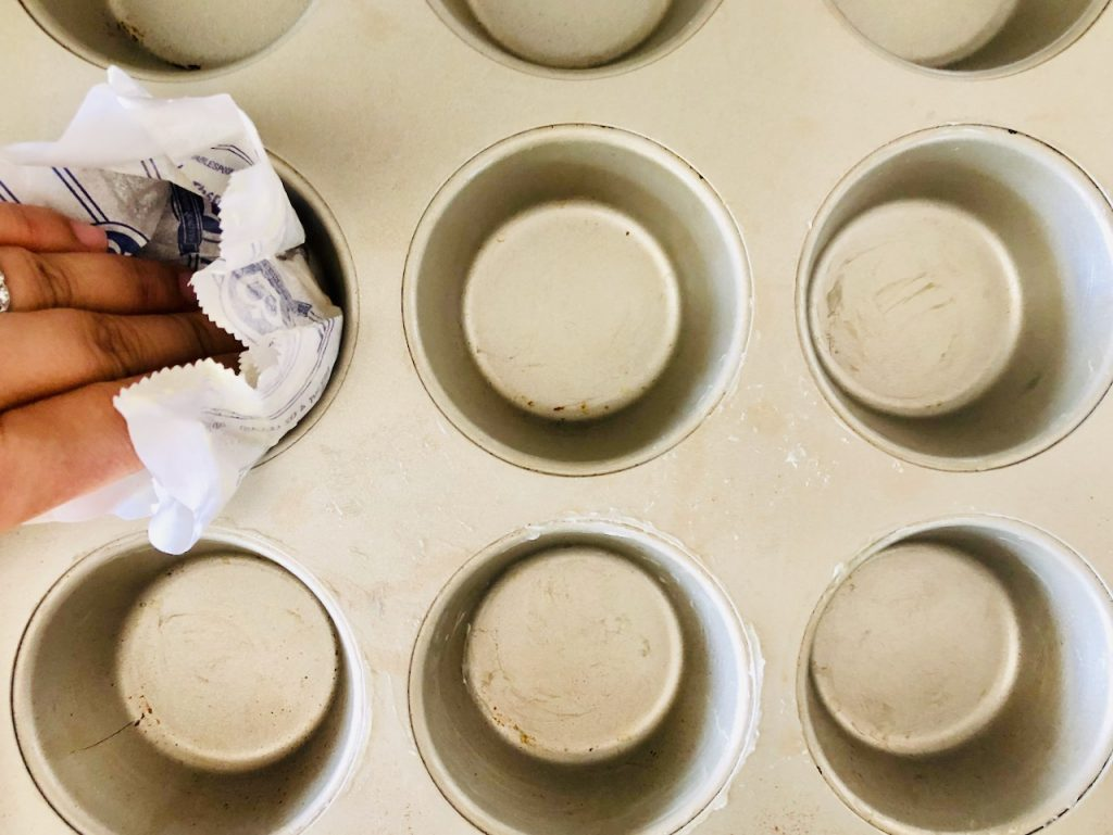 Buttering muffin tin