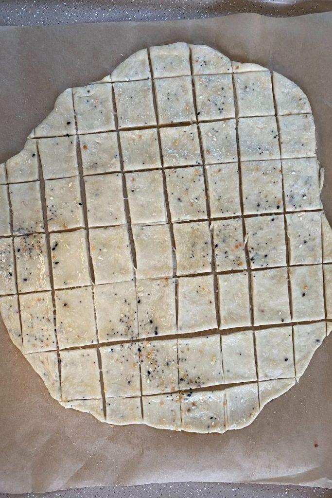Cracker dough cut into squares.