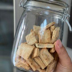 A jar of homemade sourdough crackers.